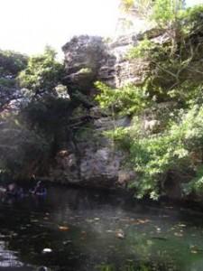 Steep rocky cliffs of limestone surrounding Cliff Pool in Bermuda