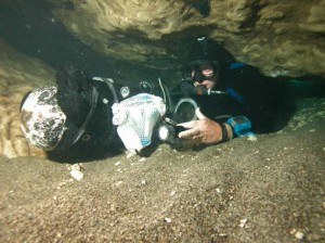 Mike Poucher enters the cave system at Wekiwa Springs State Park.