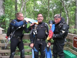 Terrence Tysall (left) and Conrad Pfeifer (right) encouraging Carl Saieva (middle, scared) to change his O-rings more often with some fully-automatic water rifles some nice folks lent us.