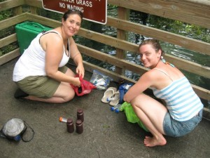 Dr. Rima Franklin (left) and Sarah Brightman, our 2010 Boston Sea Rovers Frank Scalli Annual Summer Intern (right) work to fill sample containers for the divers to take into the cave.  Leaving the full of water makes the yellow-green sample bag too positively buoyant and difficult to handle through tight restrictions in the cave.
