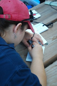 Cambrian diver and staff member Betsy Hackley prepares a slate for data collection.