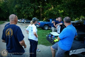 Marissa goes over sampling protocols with the dive team as they prep their gear.