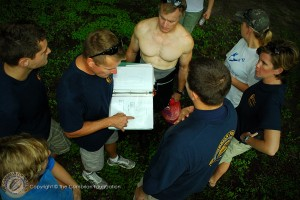 Renee, Alex, Terrence, Karl, Marissa, Amy, and Jef review the maps and sampling stations prior to walk-thrus.
